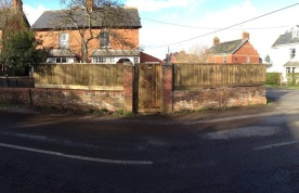 New closeboard fencing on a wall