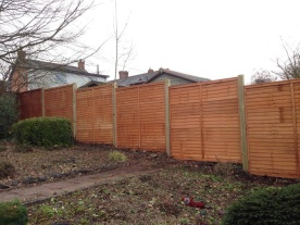 After - overlap panels on timber posts