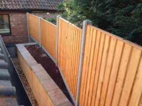 After - closeboard panels on concrete posts