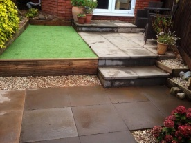 Extended patio and artificial grass after